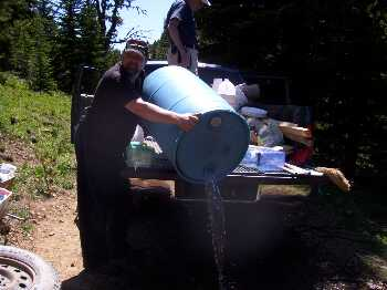 Dan dumping the water we took for the cement work.