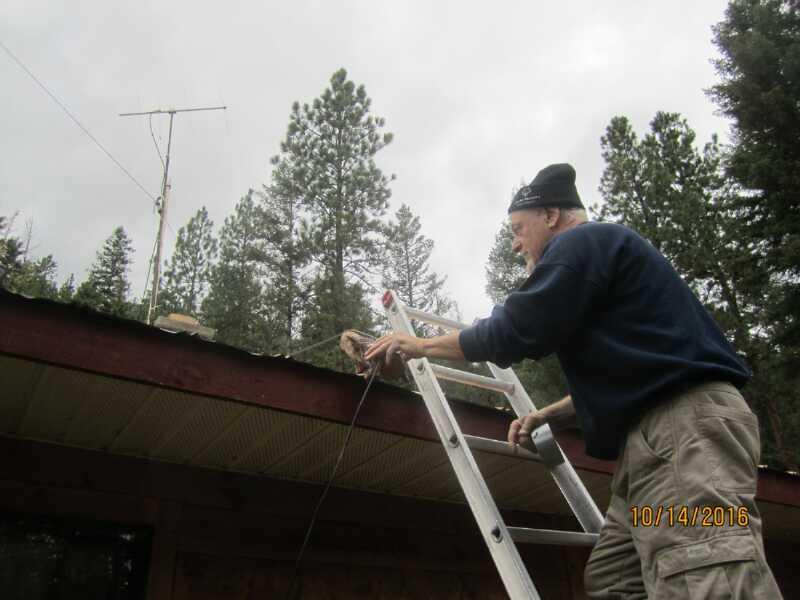 Bob VA7FMS running coax from antenna on roof